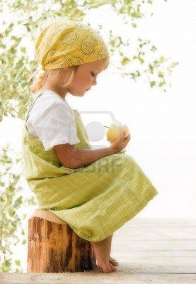 little girl looking at apple  Stock Photo - 1952326