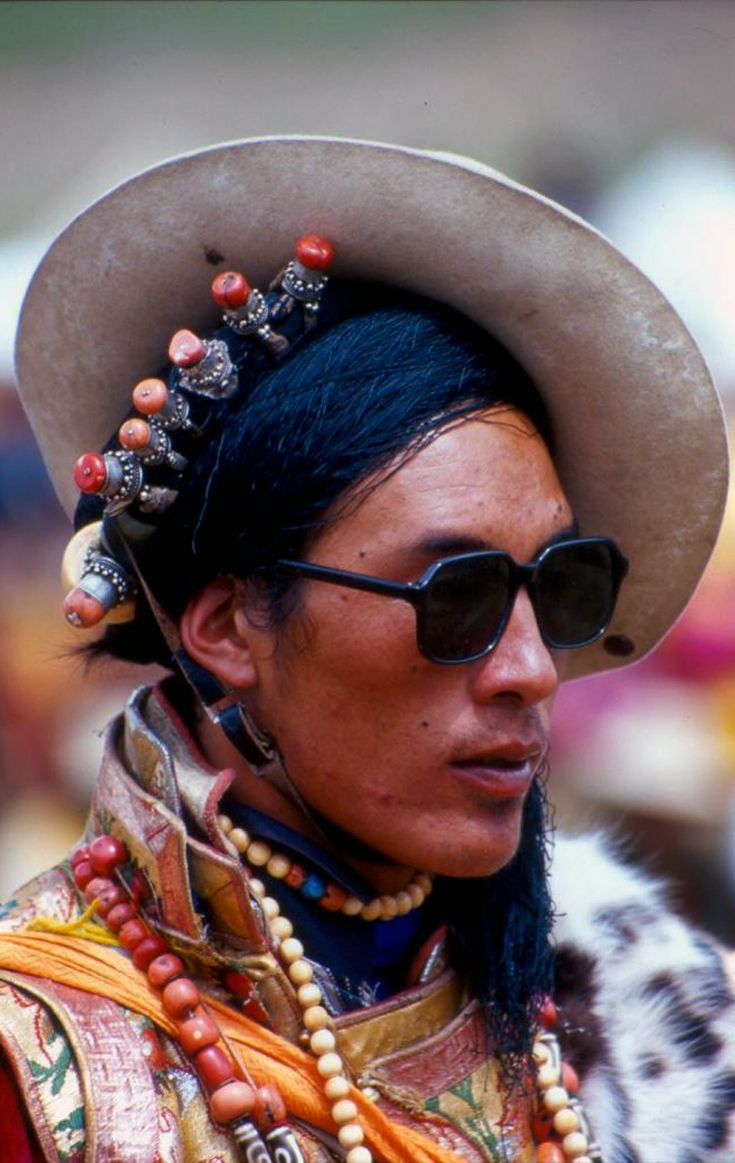 Tibet | Khampa man wearing traditional hair rings. Horse festival, 2000. Lithang | ©Stephan Elens
