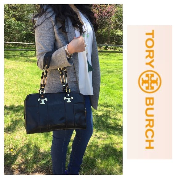 """Black Leather Tory Burch Satchel Preloved Black Leather Tory Burch satchel with gold accents.   One of the earliest Tory Burch Collections. Purchased at Nordstrom over 15 years ago.   Beautiful black leather with gold accents on handle and bag. Full zipper closer.   Has two open functional interior pockets and one zipped pocket.   The bag is in very good condition. Very clean interior. Only one mark as shown in pic.    Measurements 13"""" X 9"""" X 4""""  20"""" drop Tory Burch Bags Satchels"""