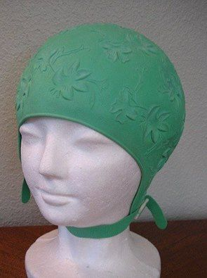 Swim cap = at one point. these caps were mandatory in public pools.