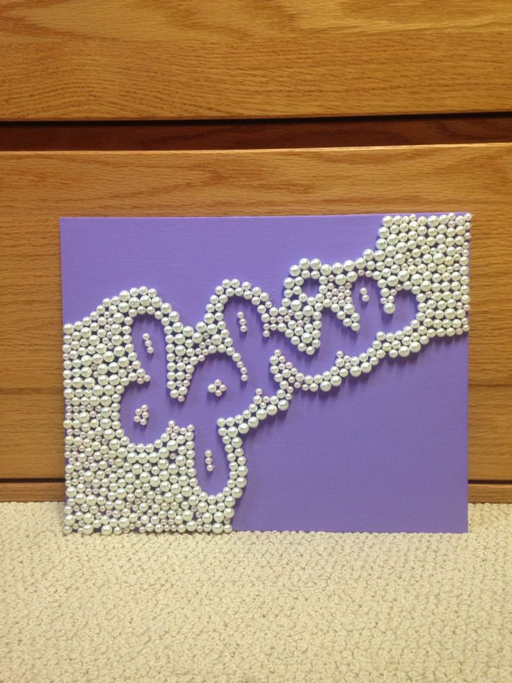 this is a replica of another Delta Phi Epsilon craft I found on here, but I was really proud of my results!  I painted a canvas panel purple and hot glued lots of pearl beads onto it.