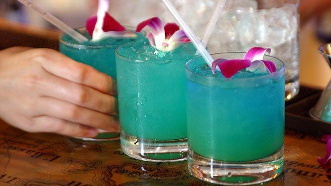 Blue Hawaii :) Ingredients: 3/4 oz. Rum 3/4 oz. Vodka 1/2 oz. Blue Caracao 3 oz. Pineapple Juice 1 oz. Sweet & Sour Ice (optional)