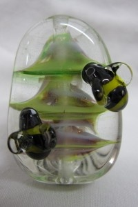 Bees decorating a christmas tree - flameworked glass www.glassbyclaire.com