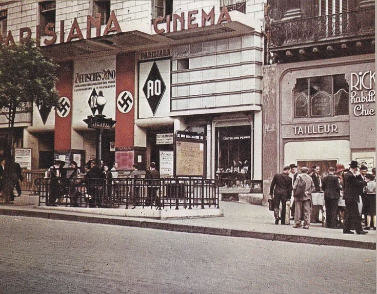 """French citizens in Paris line up to get tickets at a cinema that is screening a German film. The Third Reich possessed some of the most talented filmmakers in the world at the time. Some of the first colored cameras were used in German cinema, seen from productions like the Napoleonic war epic, """"Kolberg"""" for instance."""