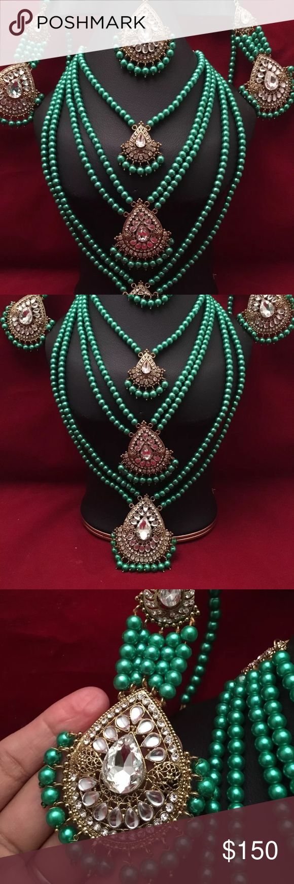 NWOT Indian bridal jewelry set New Mughal style pearl beads attached with rhinestones pendent . Set include earrings , maths Tikka and long necklace Earrings are 4.5 inches long and attached with saharas . .   Color is green like parrot green but too dark picture of Beads in hand is exact color .  Picture took in different lights to show you the exact colors . Very beautiful in front .  Please ask any question before bidding all sales are final no return accepted.  Thank you Jewelry…