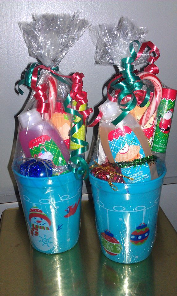 mini Christmas bubble bath, lip balm and hand lotion decorated nicely in a festive cup with a candy cane.  Complete shrink wrap and ribbon