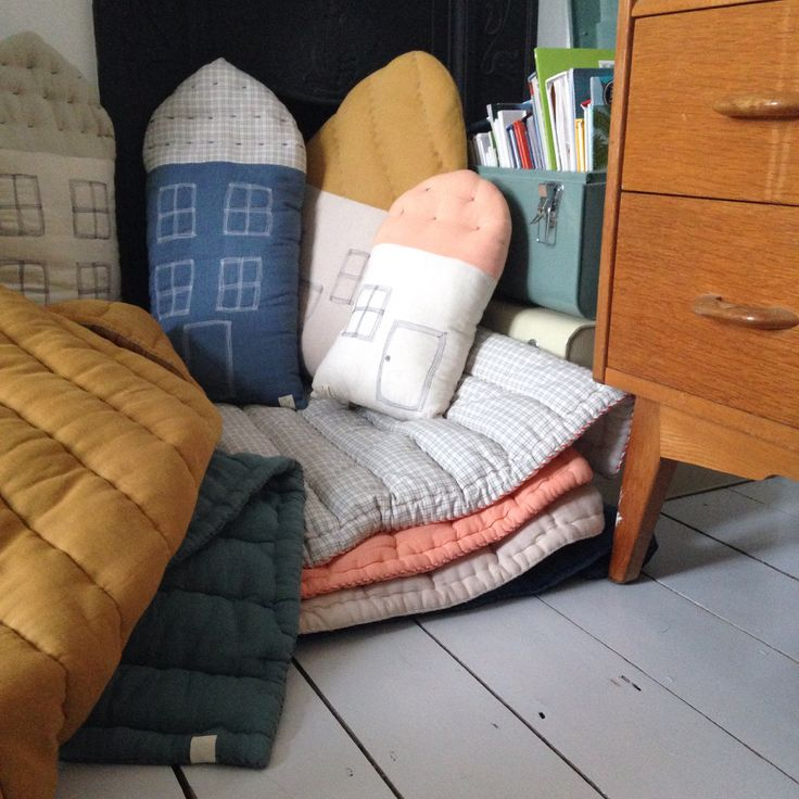 Create a reading corner for your little ones using Camomile London Hand quilted blankets layered up and house cushions. The perfect mix of relax and play. All available at www.camomile.london