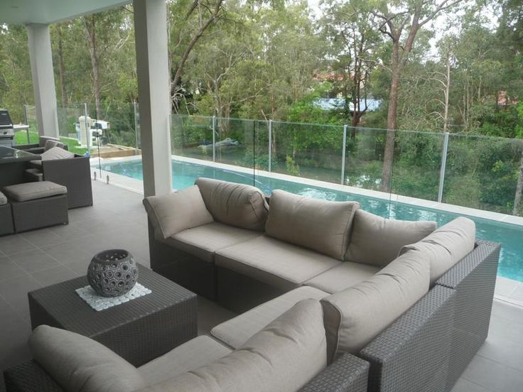 Steep site treatment of outdoor living with step-down pool