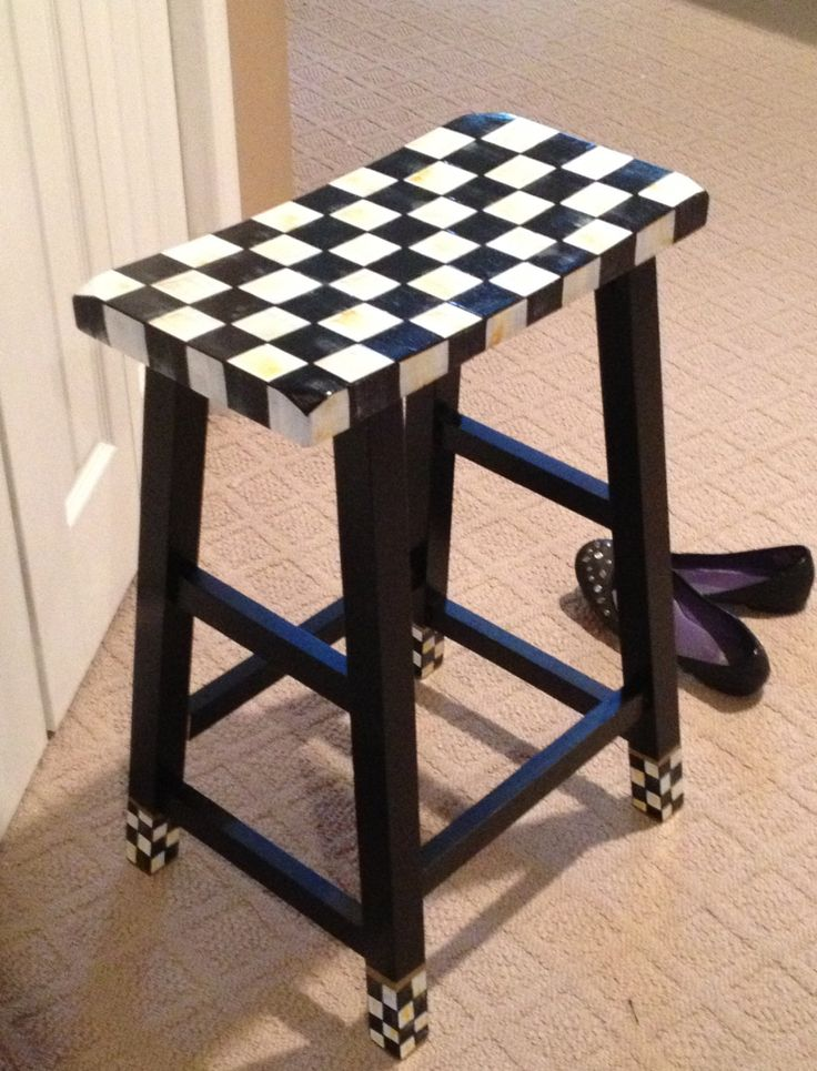 A cute twist on the plain black saddle stool - black and white checkerboard at seat and feet...