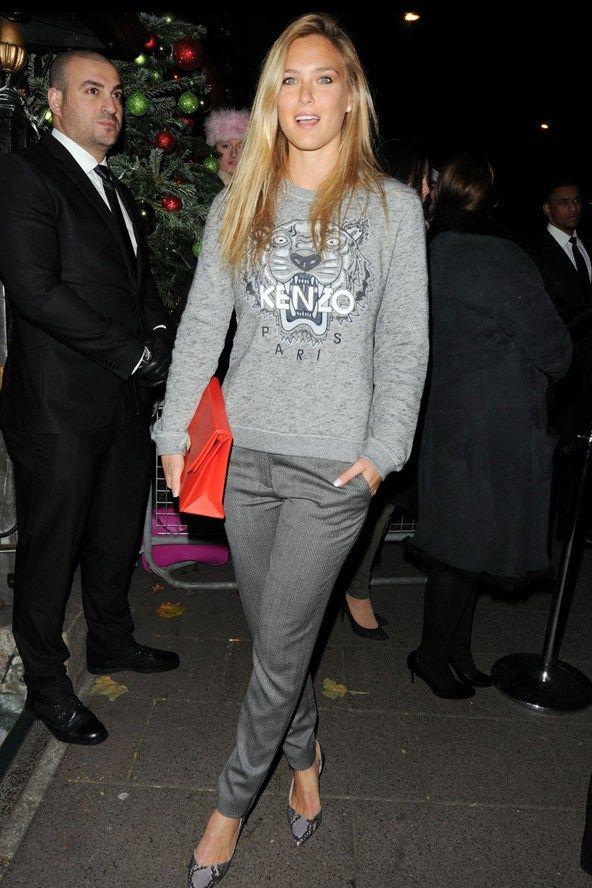 Bar Refaeli.. Kenzo jumper and slim grey trousers - many shades of grey..