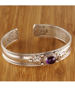 @Overstock - Handmade in Nepal by local artisans, this eye-catching piece of jewelry showcases a bright amethyst stone. Formed of white metal, this gorgeous cuff bracelet offers intricate craftsmanship.http://www.overstock.com/Worldstock-Fair-Trade/White-Metal-Oval-Amethyst-Bracelet-Nepal/3031128/product.html?CID=214117 $17.99