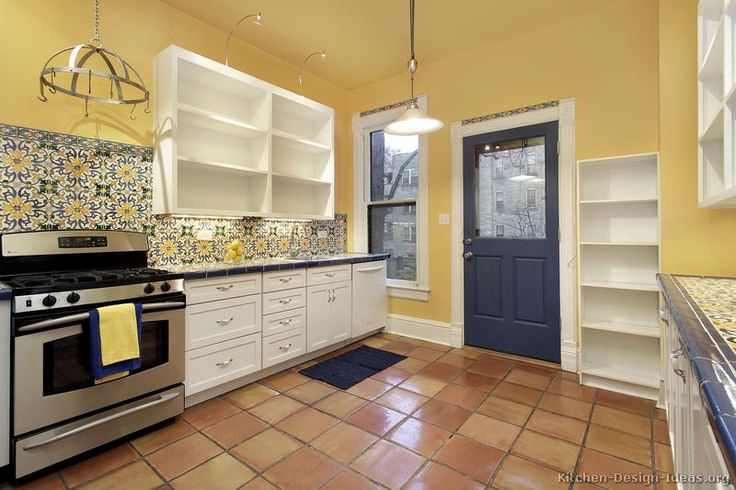 day mexican style kitchen with yellow walls ornate tile backsplash