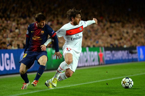 Lionel Messi Photos Photos - Lionel Messi of Barcelona and Maxwell of PSG compete for the ball during the UEFA Champions League quarter-final second leg match between Barcelona and Paris St Germain at Nou Camp on April 10, 2013 in Barcelona, Spain. - Barcelona v Paris St Germain