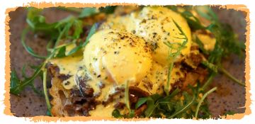 Our famous Bombay Benedict ... kinda like regular Eggs Benedict but with succulent Chicken Tikka pieces and smothered in delectable curried hollandaise.