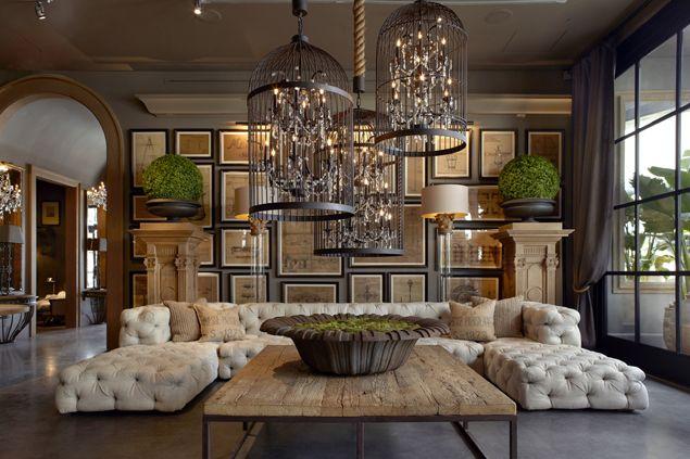 restoration hardware - sunken living room?? Tufted seating, lots of symmetry. Cool birdcage lighting.