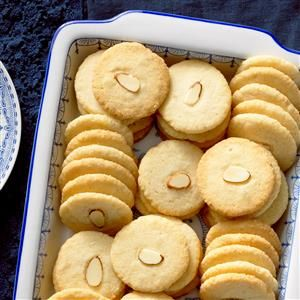 Almond Ginger Cookies Recipe -Think outside the box this season and enjoy these traditional Chinese cookies, each one topped with an almond slice. —Shirley Warren, Thiensville, Wisconsin