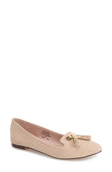 Gilded hardware and a duo of tassels add a posh look to this round-toe flat designed with a chic smoking slipper silhouette. @Nordstrom