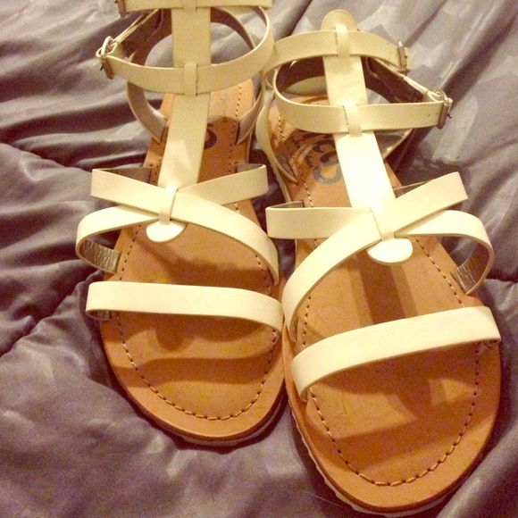White Strappy Sandals   White Strappy sandals.  Circus by Sam Edelman.  Very comfortable!  Brand new, never worn.  Two buckles.  Make me an offer!  Sam Edelman Shoes Sandals