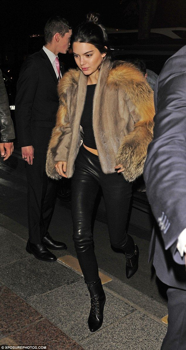 Another night, another glam look: Kendall Jenner looked gorgeous in leather trousers and a furry coat as she headed back to her hotel after a dinner atKinugawa restaurant in Paris on Friday