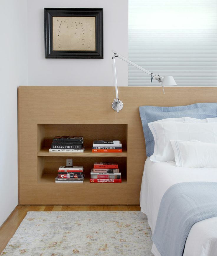 Bedroom Detail, custom headboard with built-in bookshelves. Lucio Fontana painting. And Artemide Tolemeo architects lamp.