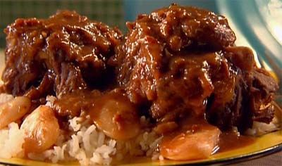 Locals love oxtail stew.  Most South Africans who love oxtail stew serve it with the bone in, but you can easily remove the bones from the meat before serving.  #food #cooking #recipes #southafrica #oxtail #stew