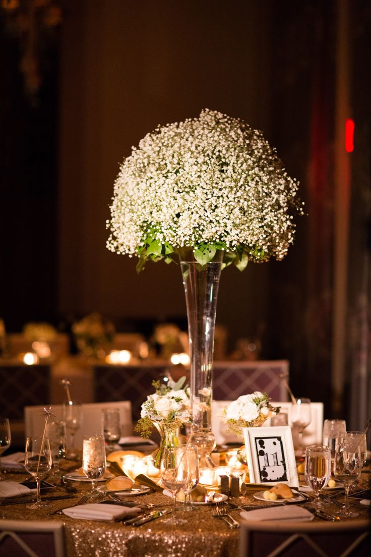 Wedding Centerpiece - Tall Baby's Breath + Sparkling Linens. See the wedding on SMP:  http://www.StyleMePretty.com/2014/05/28/glamorous-new-years-eve-wedding-in-philly/ Photography: AsyaPhotography.com - Floral Design: PetalsLane.com