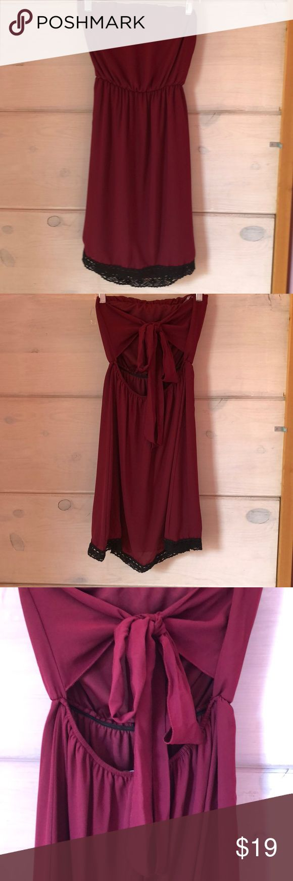 "NWT Burgundy/Black Strapless Gameday Dress This cute strapless dress ties into a bow in the back. Burgundy with black crochet trim. Lined. Made in the USA.  Measures approximately 28"" long.   Feel free to ask any questions. I accept reasonable offers. Dresses Strapless"