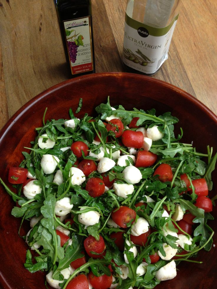 Tomato Mozzarella Caprese Salad with Arugula and fresh basil. All dressed with olive oil and balsamic vinegar.  So tasty!!