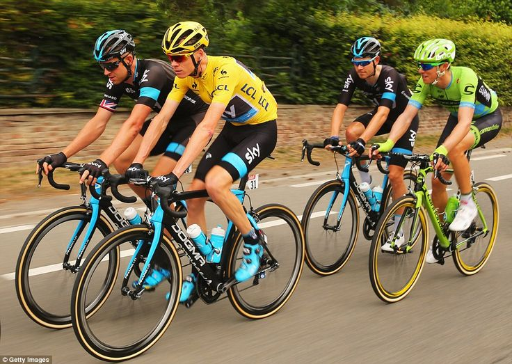 Race leader Froome rides alongside his fellow Team Sky rider Ian Stannard (left) early in the 4th stage