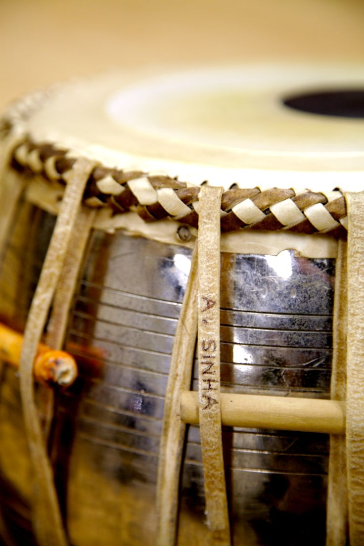 This tabla belongs to Samir Chatterjee; the tabla is a membranophone percussion instrument, which are often used in North Indian classical music
