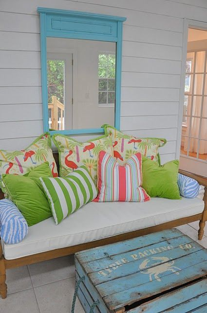This is total bedroom inspiration. I would so love to have this couch/bed in my room. The colors of the pillows are so vibrant, I love them! Also the blue door frame adds to the color scheme/appeal. Is this on someone's porch?
