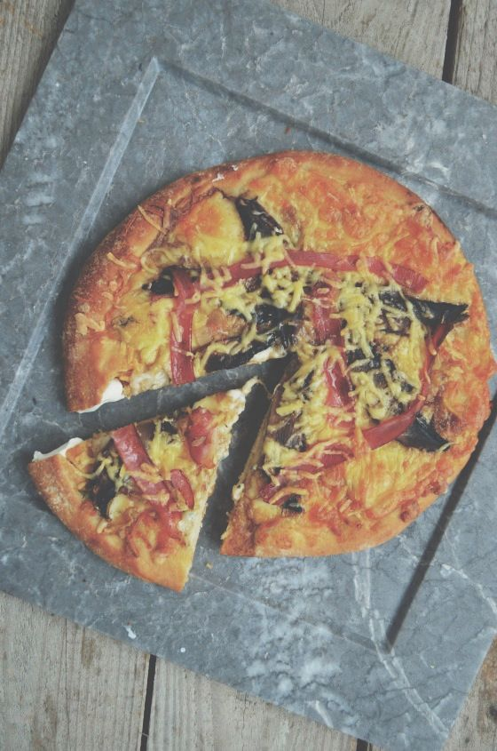 Philadelphia crust pizza with portobello mushrooms and bacon