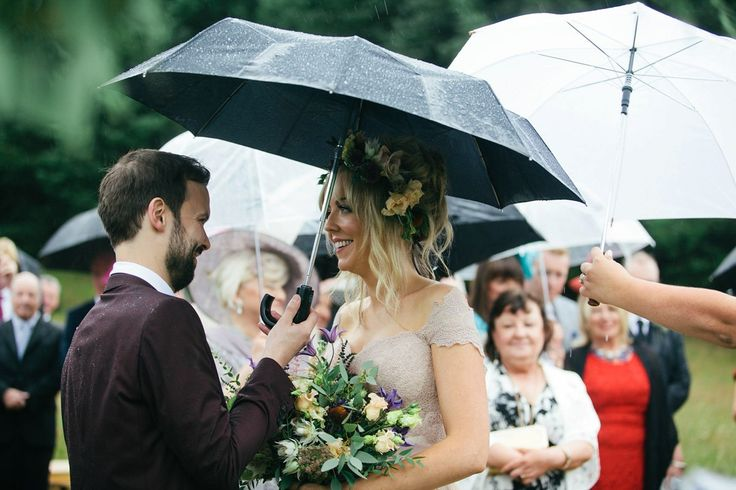 Bride and Groom from a rainy day outdoor wedding ceremony in Scotland. Captured by MIrrorbox Photography.