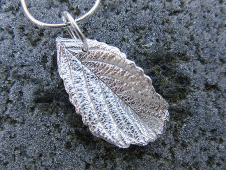 A lovely rose leaf in fine silver
