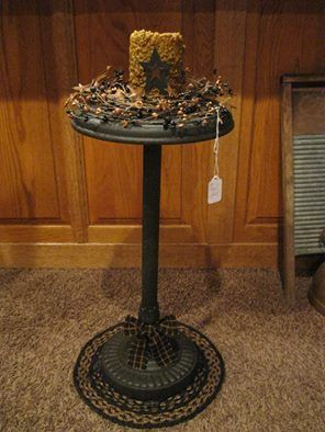 Primitive candle holder made from an old ashtray you get at yard sales and junk stores cheap,paint it and decorate it now its a floor candle holder!!!!