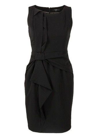 Mooie donkerblauwe jurk met korte mouwen en groene accenten aan het einde van deze mouw of verwerkt in de strik