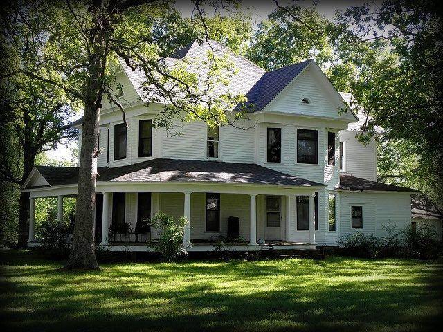 White farmhouse exterior with black window trim