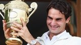 roger federer with the latest wimbledon trophy :)
