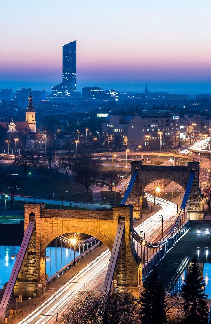 Two landmarks of Wroclaw (Poland) - Grunwaldzki Bridge, old suspension bridge built in 1910,& Sky Tower