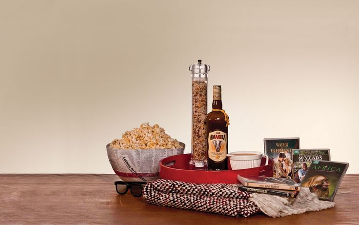 Luxurious Movie Gift Set - This gift hamper is the perfect assortment for any movie enthusiast. Create a one-of-a-kind gift selection that will provide a luxurious movie experience. A selection of African classics and delicious snacks makes for the perfect night in. Get inspired here: www.amarula.com/gifts