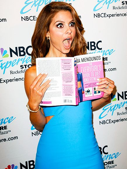 SHOCK & AWE | What's the big surprise? Maria Menounos has a must-read on her hands while promoting her new book The EveryGirl's Guide to Diet and Fitness Wednesday at the NBC Experience Store in New York City.