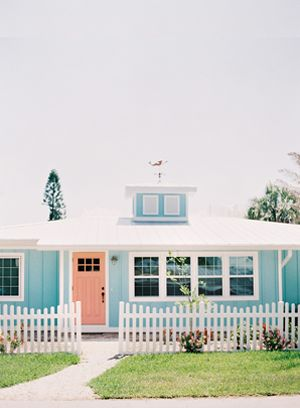 Little, turquoise beach house with a sweet, coral door.