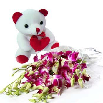 Parcel your love and passion through this perfect art flower combo of 6 purple orchids beautifully arranged in a magnificent bunch along with seasonal fillers exclusively wrapped in a cellophane sheet. This stunning arrangement comes along with a #cute #teddy #bear. Order this flower combo for the one you love, make it big! http://www.fnp.com/flowers/best-seller/flower-combo/abundance-of-love/--clI_2-cI_1123-pI_8276-pCI_1001-i_8276.html