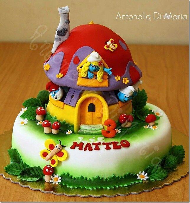 Smurfs cake so cute..