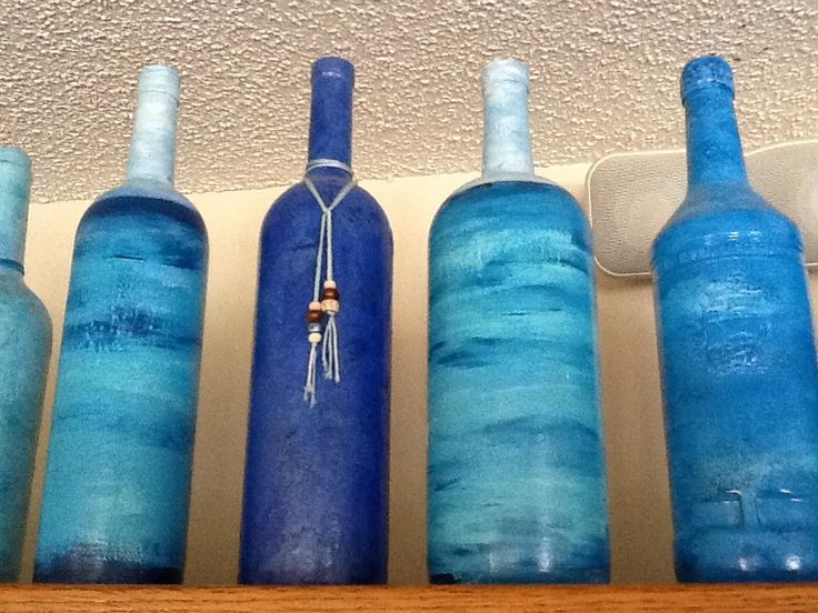 Recycled wine and liquor bottles crafts. Hand painted blue