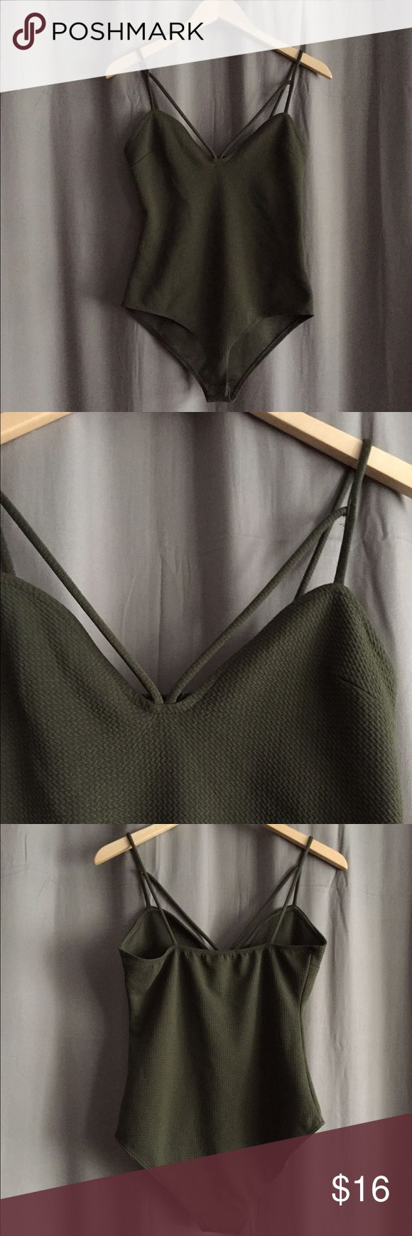 Olive green bodysuit Olive green bodysuit with double strap. Waffle texture and clasp closure. Never worn, only tried on. Size medium Charlotte Russe Tops