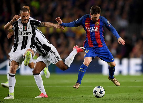 Lionel Messi of Barcelona is challenged by Alex Sandro and Leonardo Bonucci of Juventus during the UEFA Champions League Quarter Final second leg match between FC Barcelona and Juventus at Camp Nou on April 19, 2017 in Barcelona, Catalonia.