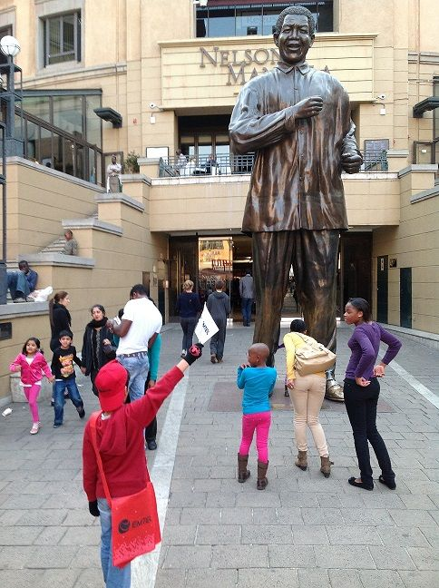 Nelson Mandela Square is a shopping centre in Sandton, Johannesburg, South Africa. Formerly known as Sandton Square, it was renamed Nelson Mandela Square on 31 March 2004 after a 6-metre statue of Nelson Mandela was installed on the square to honour the former South African president. It is attached to the large Sandton City shopping centre.
