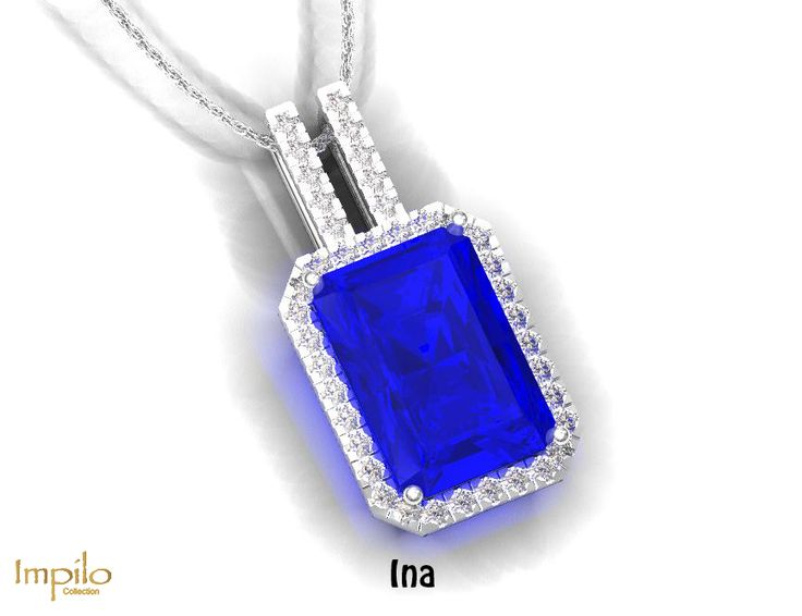 """""""Ina"""" - Lovely blue topaz surrounded by round brilliant cut diamonds and on the double bail."""