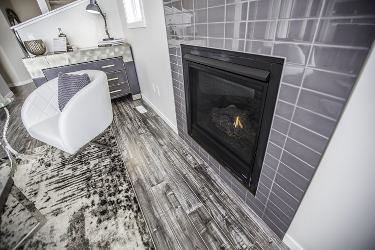 Cozy gas fireplace with beautiful grey accents!